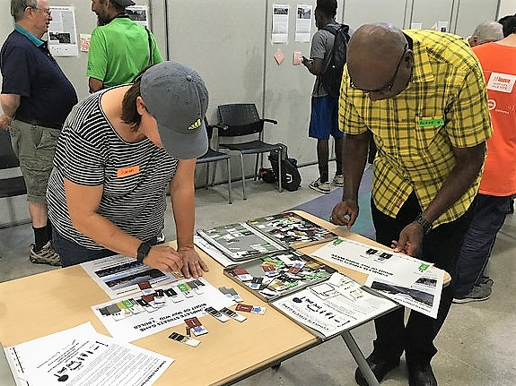 A man and a woman play the Complete Streets Game at the Scarborough Cycling Summit