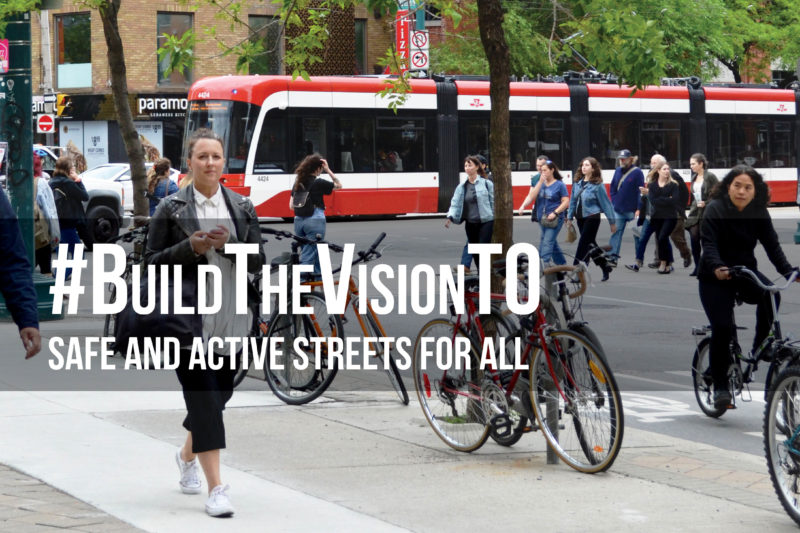 Photo of a street in Toronto with pedestrians, cyclists and a streetcar. Words on the image say: Build The Vision TO, Safe and Active Streets for All