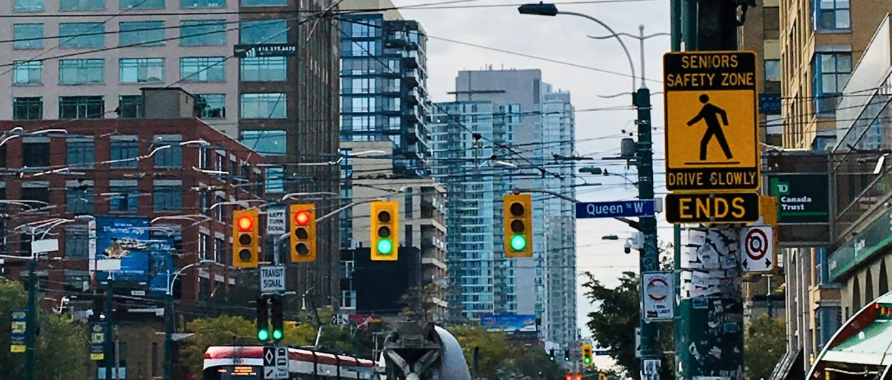 """A Toronto street with a """"Senior's Safety Zone Ends"""" sign"""