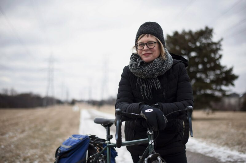 Nancy Smith Lea poses with her bicycle on a hydro corridor path in Willowdale