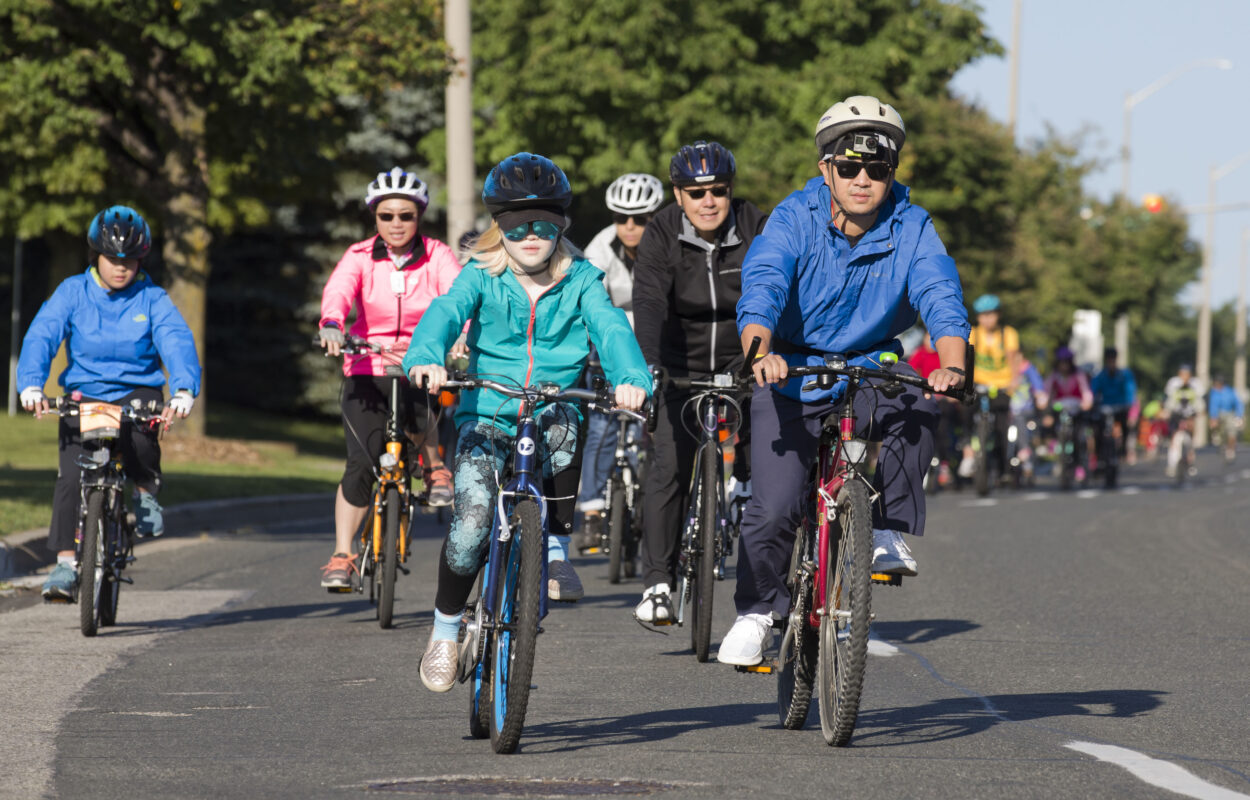 A group of adults and children on bikes in Markham